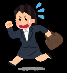 会社に急ぐ女性