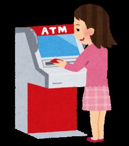 ATM操作する女性